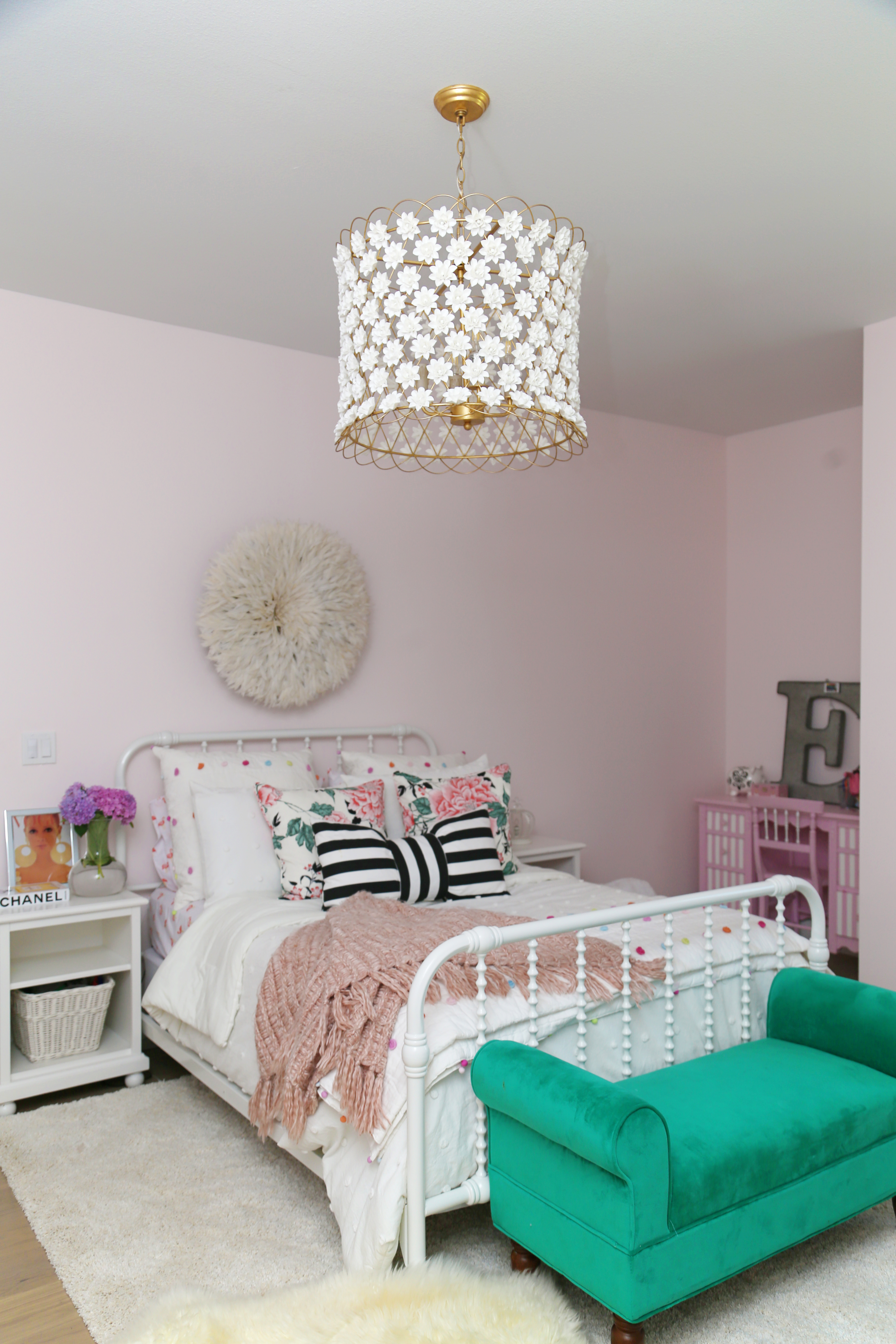 CC and Mike Frisco I Project Reveal ballet pink girls bedroom design with Jenny Lind bed and juju hat hanging above the bed black and white striped bow pillow