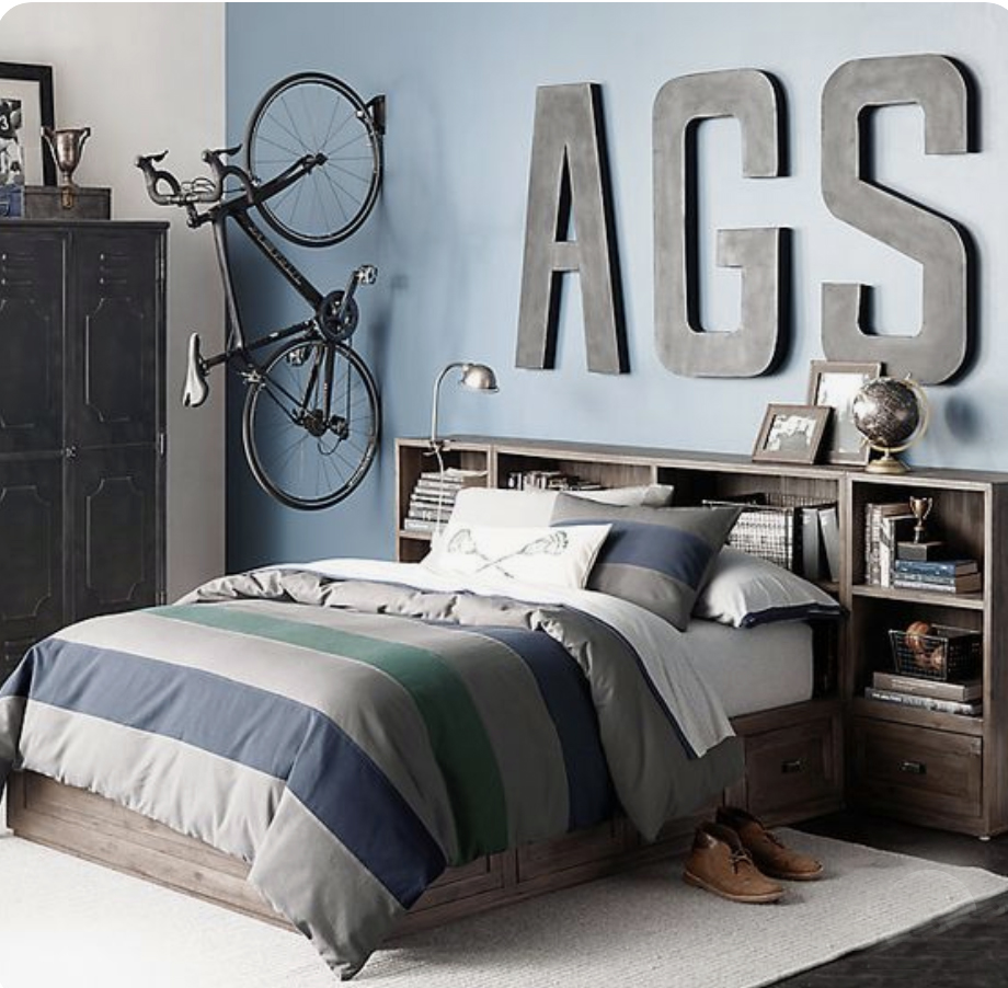 5 Tips for Boys Bedroom Design navy accent wall large metal striped bedding wood bed bicycle hanging on the wall