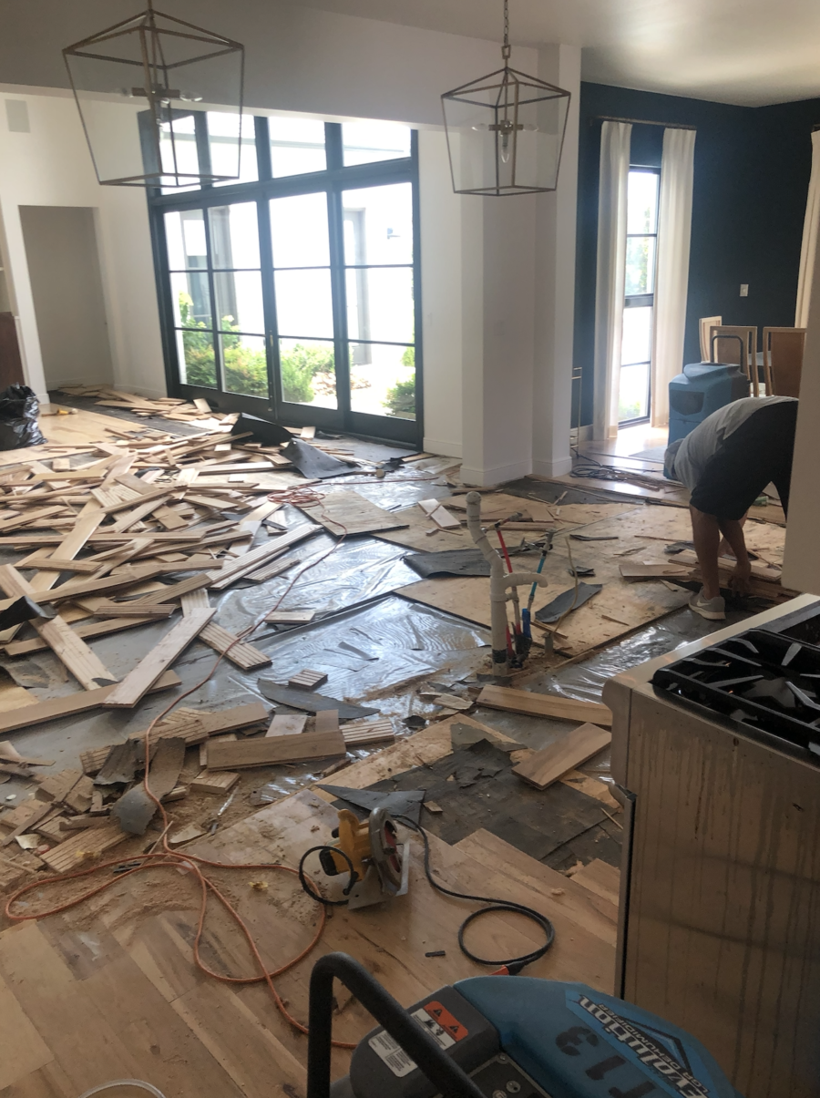 CC and MIke Kitchen Remodel Reveal large natural wood island with quartz countertops and gold bar stools black and gold pendants Ann sacks patterned backsplash gold Brizo faucet large Kallista stainless steel sink open floorpan
