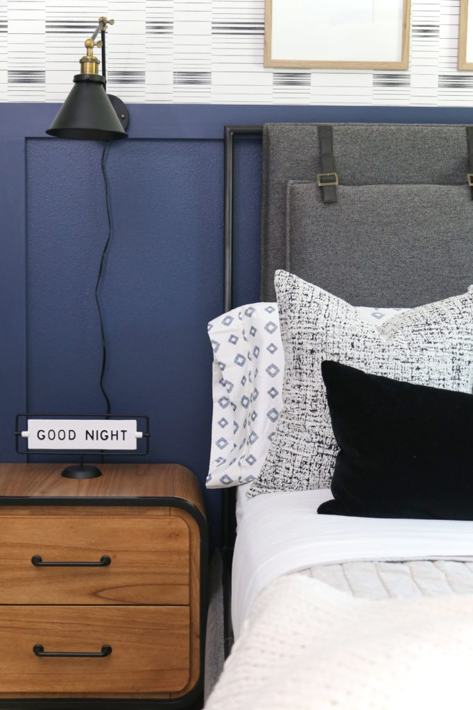 A mid-century modern nightstand and an antique-inspired wall lamp for a Teen Bedroom Reveal