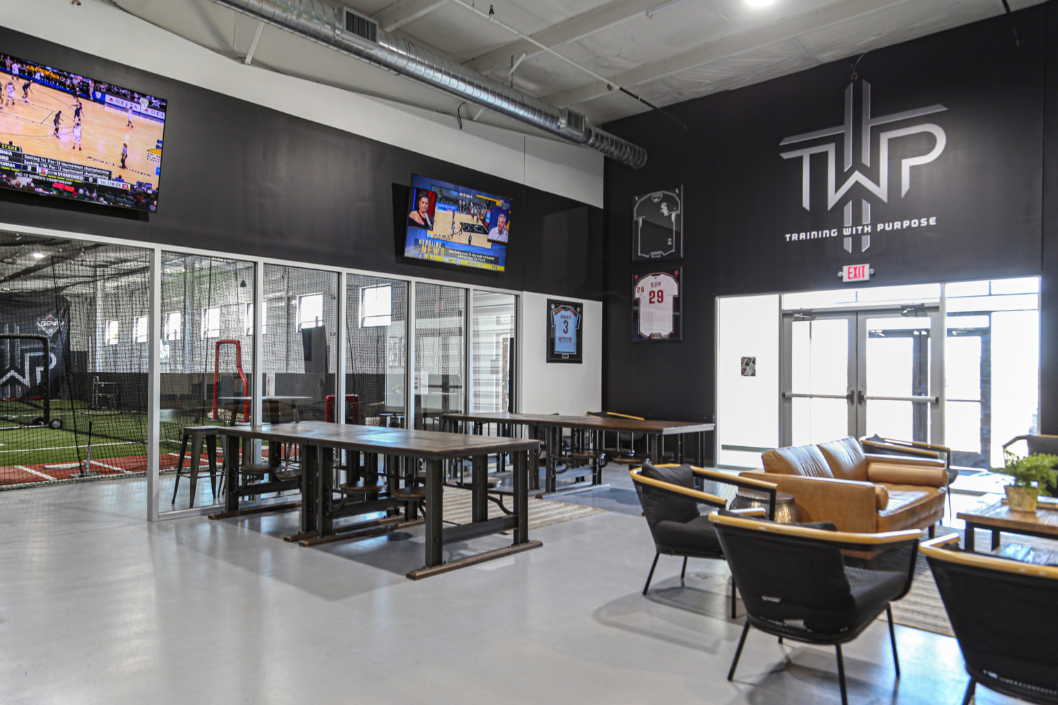 The Sports Armory interior featuring cafeteria tables from World Market